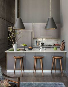 Athena Calderone's Brooklyn kitchen. Thomas O'Brien pendant lights with stools from Organic Modernism.