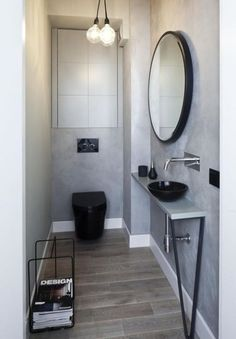 Talk about tiny bathroom. Really smart use of a small space, and I'd take that magazine rack out....