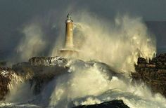 Island Lighthouse Mouro, Spain getting hit by waves. Photo by Rafael G. Great Places, Beautiful Places, Lighthouse Storm, Surf, Ocean Storm, Beacon Of Light, Great Shots, Coups, Pretty Pictures