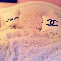 Chanel pillows + fuzzy blanket and pillow