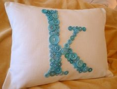 Buy a white pillow and let MC make her own monogram