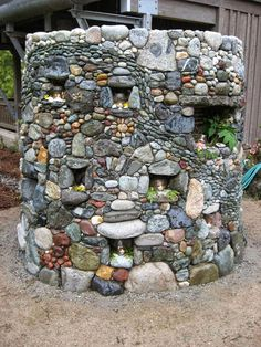 I think I can build a thing like this around our well to hide it. it wouldn't be 2 big and would be fun! from Jeffrey Bale's World of Gardens