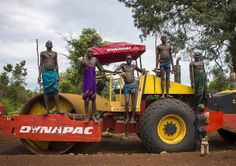 Bodi tribe warriors Posing Proudly on a bulldozer near Hana Mursi, Omo Valley, Ethiopia