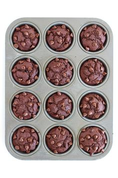 Healthier Chocolate Chocolate Chip Muffins - made with whole wheat flour, greek yogurt, no butter or oil, and sweetened with all-natural flavored cane syrup.