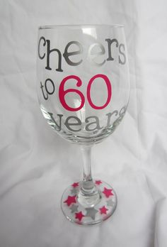 60th Birthday Wine GlassCheers to 60 by MoreShenanigans on Etsy, $12.00