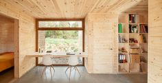 Inside Casa GG by Alventosa Morell Arquitectes. The classic Eames DSW chairs make the perfect accompaniment to the timber frame don't you think? http://www.nest.co.uk/search/vitra-dsw-eames-plastic-side-chair See more of the interior on Dezeen.