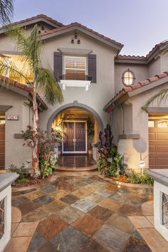 Gorgeous custom stone entryway on this Huntington Beach home - Listed by Jody Clegg | First Team Real Estate