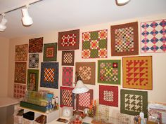 INSPIRED BY ANTIQUE QUILTS Isn't this a great way to display small quilts?  Now to find a wall big enough to do so. I've got enough quilts, I think.