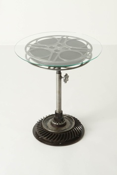 a vintage 35mm film roll, automotive gears and glass make up this VERY cool FILM REEL END TABLE....at anthropologie..... :-)