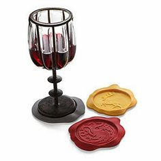 """Wax Seal"" Game of Thrones coasters--I have these in my house and at work. They will live in my Tudor-inspired living room, and everyone will be jealous."