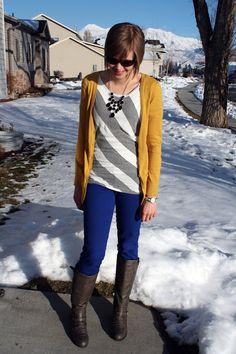 Mustard cardigan, cobalt blue skinny jeans, gray riding boots, black and white stripes, statement necklace