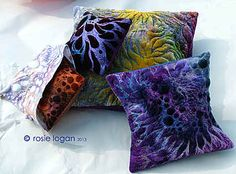 Pillow covers by Rosie Logan.
