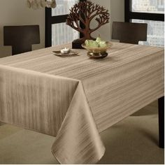 #7: Benson Mills Flow Spillproof 60-Inch by 120-Inch Fabric Tablecloth, Ivory.