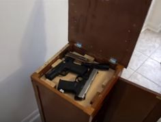 Secret Gun Compartment in Nightstand - A YouTube user made this DIY hidden compartment for $5 using small hinges and a second hand nightstand.