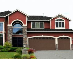 I painted my house exactly like this 2 years ago!! Same door color and shingles also! Manchester Red 4-17