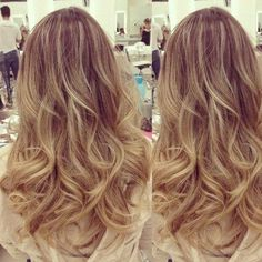 Gorgeous dark blond with highlights and soft bouncy curls