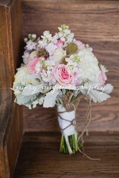 bridesmaid bouquet of white hydrangea, pink o'hara garden roses