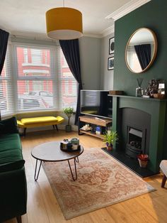 Our Edwardian/Victorian terraced house living room. We've used shades of green (Galapagos by Valspar) along with mid-century modern furnishings and a velvet green sofa. Dark Green Living Room, Dark Living Rooms, New Living Room, Home And Living, Living Room Decor Green, Living Room Lighting, Modern Living, Victorian Living Room, Interior Minimalista