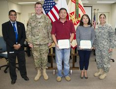 https://flic.kr/s/aHsknvHpL9 | DPW Award Ceremony | Several employees from various offices and divisions in the U.S. Army Garrison Japan Directorate of Public Works were recognized for their outstanding performance and achievement. USAG Japan Commander, Col. William Johnson, along with USAG Japan Command Sergeant Major, Command Sgt. Maj. Rosalba Dumont-Carrion, presented the DPW employees with their awards. (U.S. Army photo by Lance Davis)