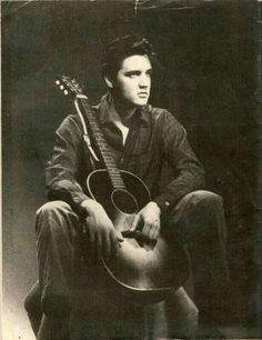 Elvis with his guitar