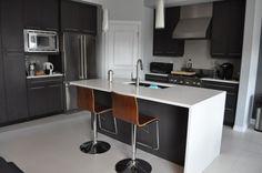 white quartz dark cabinets waterfall kitchen