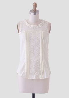 Perfected in a buttercream hue, this soft cotton blouse features scalloped embroidery and pintuck details down the front. Perfected with a sheer mesh yoke with scalloped detailing, this fitted bl...