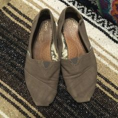 Gray toms Gray toms. Have been worn maybe ten times. Good condition, could be washed to look new. I've never washed toms, so I wasn't sure! Magic eraser is what I always used. Love these, but hardly wear anymore. TOMS Shoes Flats & Loafers