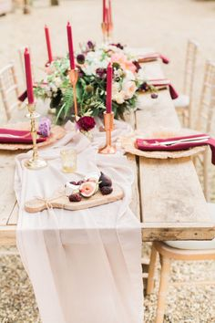 Pastels and jewel tones can certainly live together, and this meeting of innocence and sensuousnesshas no better place than at a wedding. This tablescape makes use of a sheer pastel table runner, accenting its whimsywith more serious hints of ruby red. Via Whimsical Wonderland Weddings