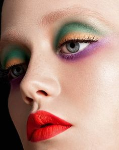 Green yellow purple eyeshadow red orange lips