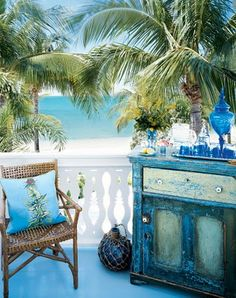Verandah view using wonderful painted chest, bamboo chair and pillow with nautical theme. Neat look.