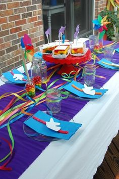 Idea for table runner decoration. Rainbow & Unicorn Party including info on how to do a rainbow sheet cake.