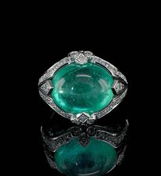 Art Deco jumbo Columbian emerald and diamond rare ring.:
