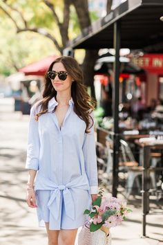blue button-up shirtdress with tie detail at waist. classic spring style outfit