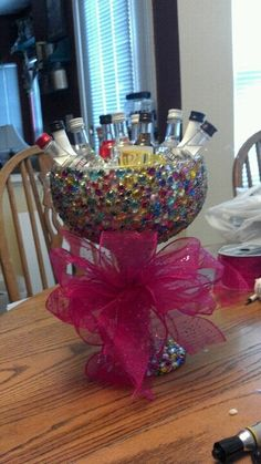 x-tra large glass margarita glass, rhinestones, mod podge, glitter! Great 21st Birthday Present! made by: Kristen