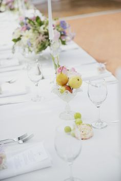 Check out how the Wedding Chicks mixed fruit and flowers on their Spring wedding tablescape.