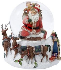 Santa Claus Snow Globe Musical Water Glass Christmas Kids Toys Classic Rudolph Musical water globe Measures approximately 100mm Plays the tune We Wish You A Merry Christmas Beautifully detailed addition to your holiday decor This Santa Claus Snow Globe by Kurt Adler is a fun, festive way to add to your holiday décor. Featured inside the clear globe is a rosy-faced Santa Claus, bag of toys in tote, getting ready to climb down the chimney. At the snowy white base of the water globe are his…