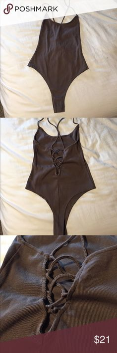 Tobi mocha colored halter bodysuit Worn once, in perfect condition. Too small on me (size XS) but super cute. Mocha colored that can be worn with almost anything. String cross back. Tobi Other