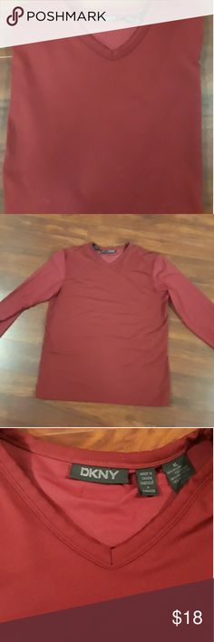 Men's DKNY Long Sleeve Shirt This shirt is thin and breathable. My husband wore it a few times. EUC. It is red but a much more deeper red than what it appears in picture. Materials are 49% Nylon,  35%Polyester  and 16% Spandex Dkny Shirts Tees - Short Sleeve