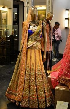 Just slip on this dress. A sunset yellow lehenga with light ombre dupatta to put on head. This is my favourite piece among all. Paired with a royal blue blouse and dupatta seems to me pre-stitched and hassle free. For veil, another light weight sheer dupatta has been provided.