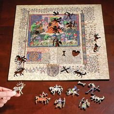 To start on a mahogany table inside my library.... Morgan Library Illuminated Manuscript Woodcut Puzzle - Levenger