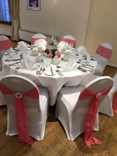 Wedding breakfast set up with coral lace sashes, diamante detail & bird cage centre piece with matching coral & cream peonies plus candle. Want your own quote? Then email me with your ideas! hello@beckiemelvinevents.co.uk More styles can be seen at www.beckiemelvinevents.co.uk