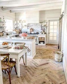 White on white farmhouse kitchen with parquet floor