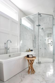 This bathroom renovation included a larger corner, curbless shower, freestanding air tub and custom paneled walls. High quality porcelain tiles have a realistic carrara marble look while offering the…More Glass Bathroom, Custom Bathroom, Bathroom Pictures, Bathroom Interior, Amazing Bathrooms, Bathrooms Remodel, Elegant Bathroom, Tile Bathroom, Bathroom Design