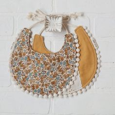Our handmade Harvest Bib comes with a floral on one side, and a linen fabric on the other with floral lace down the middle. Couture Lin, Hand Crochet, Crochet Hats, Billy Bibs, Boho Vintage, Easter Bunny Decorations, Cotton String, Crochet Patterns For Beginners, Learn To Crochet
