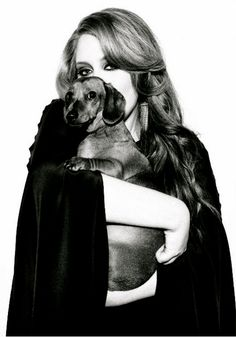 Adele and her dachshund (or as she calls it, her sausage dog) Louie, named for Louis Armstrong