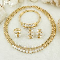 2018 Fashion New White Imitation Pearl Jewelry Sets Charm Bride Wedding Women Necklace Earrings Italy Dubai Jewelry Accessories. Yesterday's price: US $27.98 (22.97 EUR). Today's price: US $12.03 (9.91 EUR). Discount: 57%.