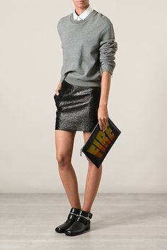 30 Outfits To Wear With Every Boot Style This Fall #refinery29  http://www.refinery29.com/fall-boots-outfit-ideas#slide19  Pick up on the hardware of exposed zippers with metallics and grays.