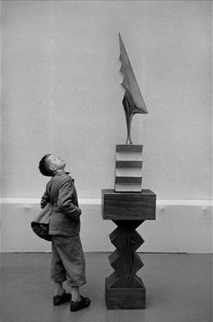 Rene Burri: A sculpture by Constantin Brancusi at the Kunsthaus Museum, Zurich, © Rene Burri / Magnum Photos. From evencleveland How genuinely interested this kid is :) Brancusi Sculpture, Art Sculpture, Abstract Sculpture, Totems, Constantin Brancusi, Sculpture Lessons, Action Painting, Art Moderne, Coq