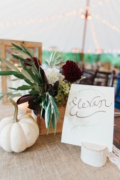 Perfect fall wedding colors deep plum white pumpkin handwritten table number sign on birch stand on burlap runner at Willowdale Estate in Topsfield, Massachusetts www.willowdaleestate.com