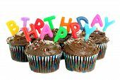 Picture of happy birthday chocolate cupcakes on white.